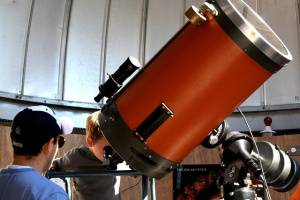 NH Observatory Manager Ian Cohen safely shows a young observer the Sun through the Observatory's main telescope, a 14-inch reflector. Credit: Loni Anderson/NEFAF